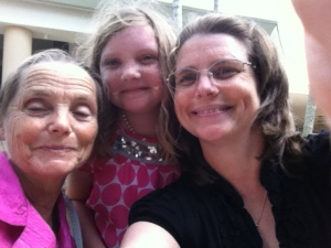 My beautiful mother, the Girl, and me..at Starbucks...where I spent money...but it's on my mom so it's okay....