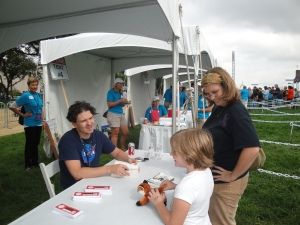 The Girl charming Dave Eggers at the National Book Festival.
