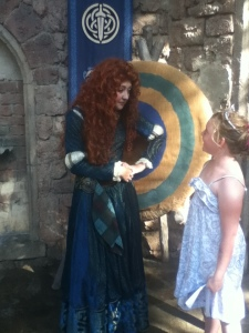 The Girl meeting Merida who is nowhere as brave as my daughter.